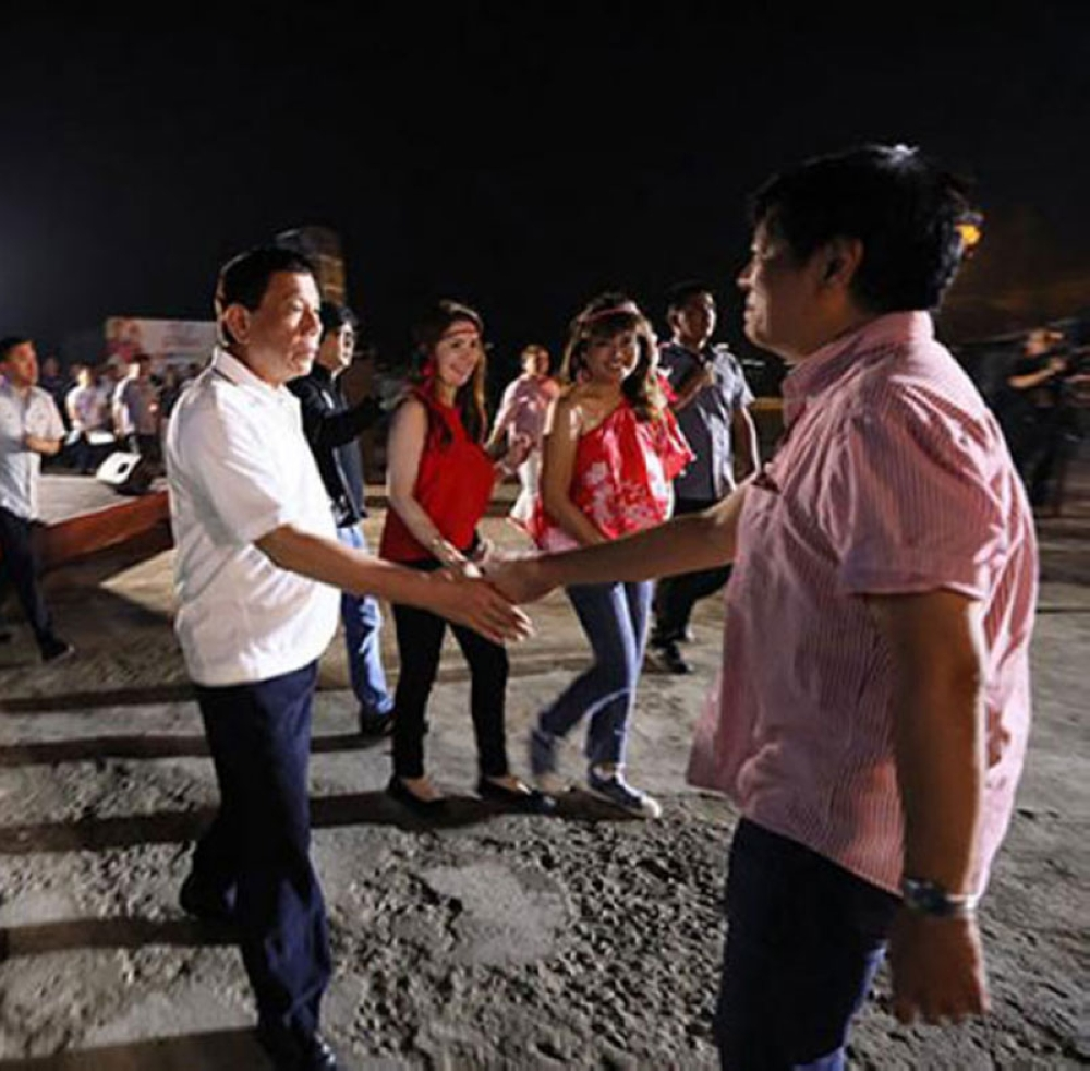 TACLOBAN. In this file photo taken on June 29, 2018, President Rodrigo Duterte greets former senator Ferdinand 'Bongbong' Marcos, Jr. on the sidelines of his attendance to the Sangyaw Festival of Lights held in Tacloban City, Leyte. (File Photo)