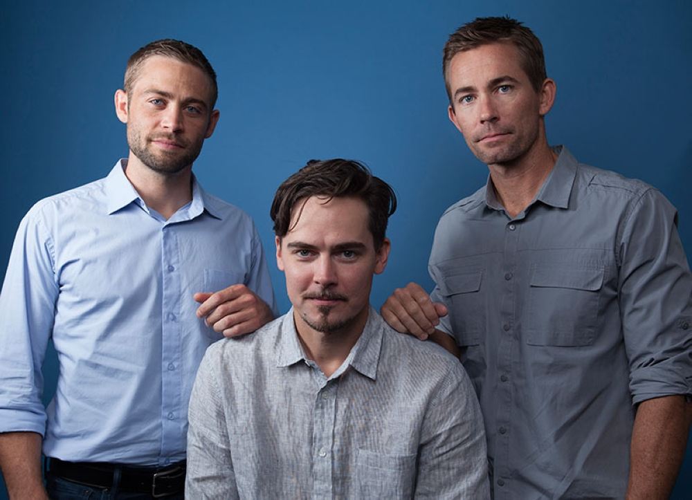 In this Wednesday, Aug. 8, 2018 photo, Cody Walker, from left, Adrian Buitenhuis and Caleb Walker, pose for a portrait in Los Angeles, in promotion of the documentary film 'I Am Paul Walker.' The new one-hour documentary about the actor's childhood, family and career is directed by Buitenhuis. It premiered last weekend on the Paramount Network. (Invision/AP)