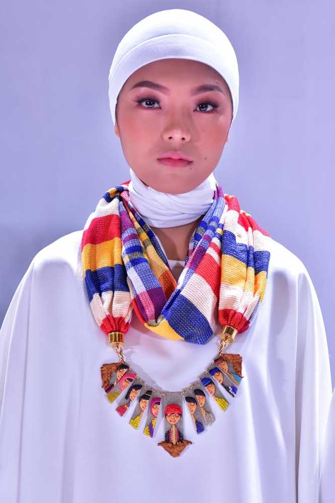 DAVAO. Kathryn Fanlo's Habi Kadayawan 2018 winning piece 'Pahidungog' for the Hobbyist and Artisan Kadayawan category is inspired by the 11 tribes of Davao. The piece is shown during the fashion show and awarding held at SM Lanang Premier in Davao City on Thursday, August 16. (Photo by Macky Lim)
