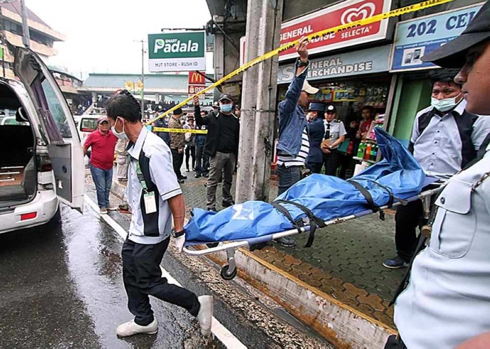 BAGUIO. A pawnshop clerk was killed Wednesday morning in what appeared to be a robbery attempt in Abanao Street, Baguio City. But, the crime was reported around 1:50 p.m. (Photo by JJ Landingin)