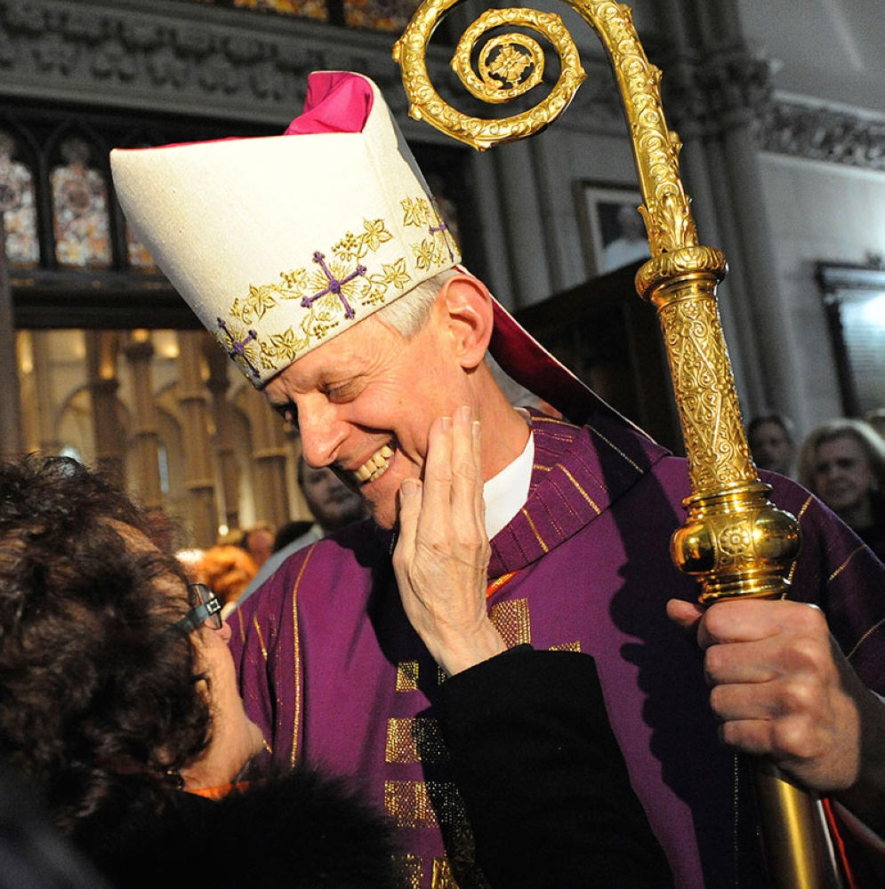 In this Dec. 12, 2010, photo, Cardinal Donald Wuerl, the Archbishop of Washington, greets a woman after giving a Mass of Thanksgiving at St. Paul Cathedral in Oakland neighborhood of Pittsburgh. A landmark grand jury report released Tuesday, Aug. 14, 2018, faulted Wuerl, the former longtime bishop of Pittsburgh who now leads the Washington archdiocese, for what it said was his part in the concealment of clergy sexual abuse. Wuerl, one of the highest-profile cardinals in the United States, released a statement Tuesday that said he had 'acted with diligence, with concern for the victims and to prevent future acts of abuse.' (Pittsburgh Post-Gazette via AP)