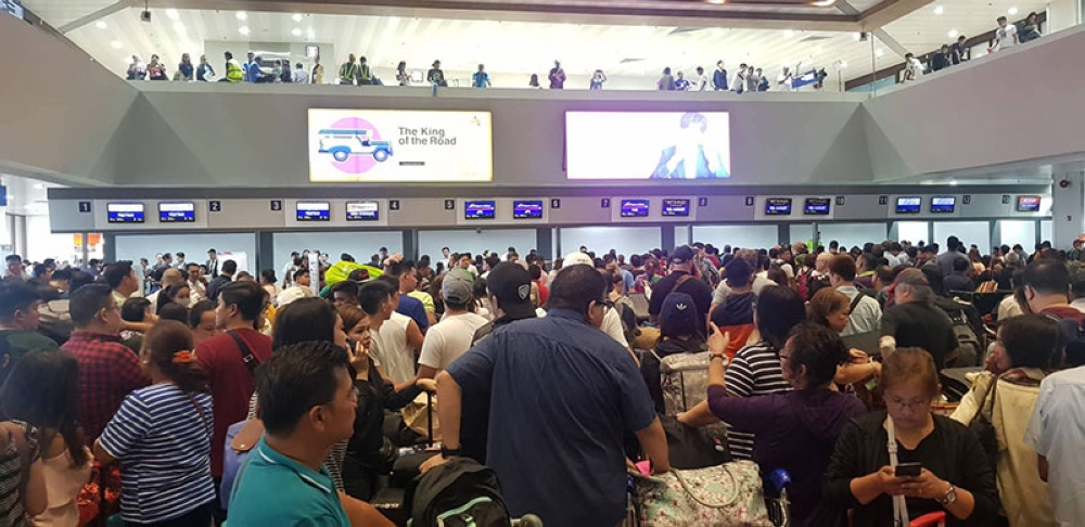 MANILA. The check-in area of the Ninoy Aquino International Airport (NAIA) Terminal 1 is packed with stranded and newly arrived passengers. NAIA's international runway 06/24 was reopened shortly before 12 noon Saturday, August 18, more than 24 hours after a Xiamen Air aircraft slid off the runway under heavy monsoon rain. (Photo courtesy of Paolo Gonzales Bago)
