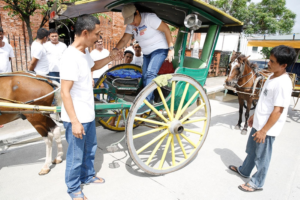 PAMPANGA. Calesa driver Marcelino Aquino showcases the proper way of dealing with passenger as a tour guide during the Calesa Drivers as Tourism Frontliners Seminar and Workshop on August 15 to 16 at San Fernando Old Train Station. (Photo courtesy of CSF-CIO)