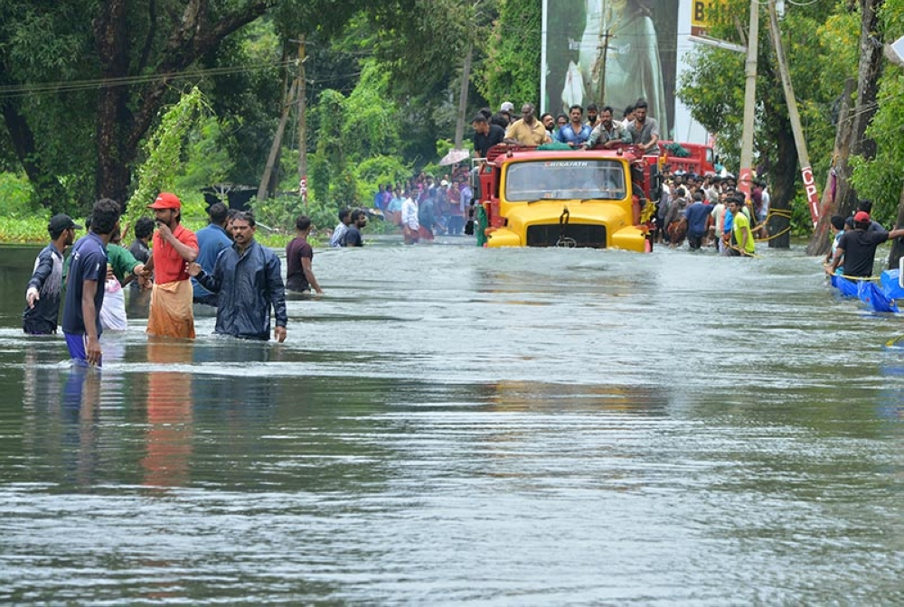 INDIA. A truck carries people past a flooded road in Thrissur, in the southern Indian state of Kerala, Saturday, August 18, 2018. Rescuers used helicopters and boats on Friday to evacuate thousands of people stranded on their rooftops following unprecedented flooding in the southern Indian state of Kerala that killed hundreds, officials said. (AP)