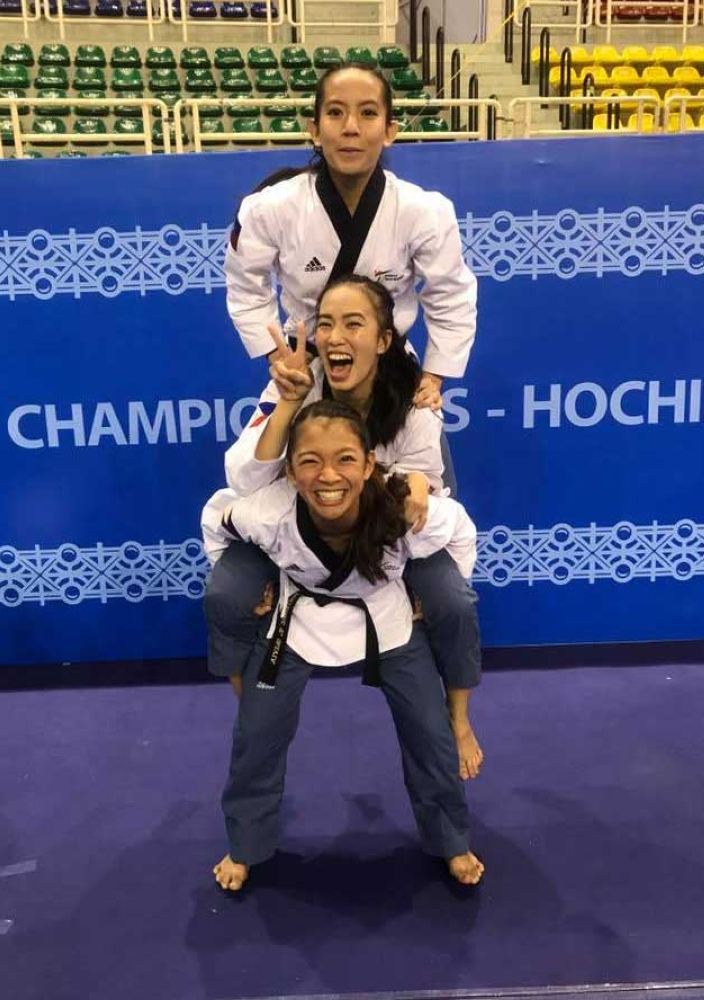 RINNA SANDWICH. Rinna Babanto and her teammates Faye Crisostomo and Janna Oliva finished with a bronze medal in the Asian Games women's team poomsae. (Rinna Babanto's facebook page)