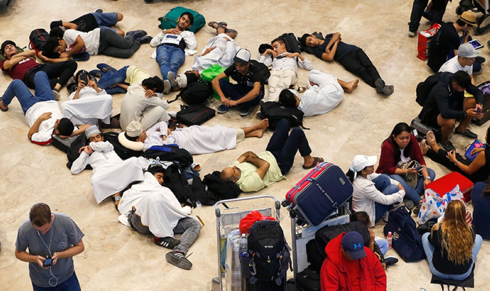 MANILA. Stranded passengers sleep at the lobby of the Ninoy Aquino International Airport more than 24 hours after Xiamen Air skidded off the runway while landing under a heavy downpour . The accident forced the closure of the international runway and stranded thousands of passengers on international flights. (AP Photo)