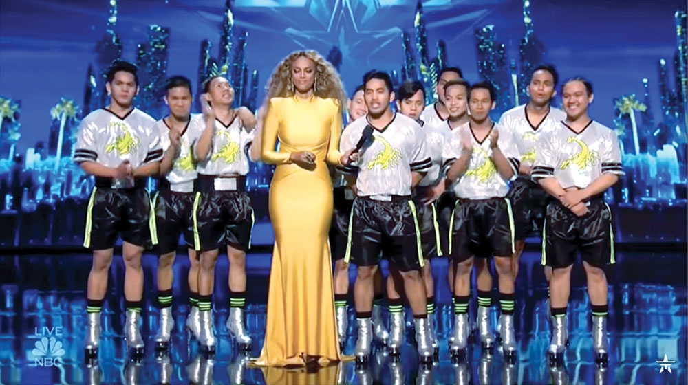 "Tyra Banks with the Junior New System during the performance night of  ""America's Got Talent.""  (Screengrab / Youtube)"