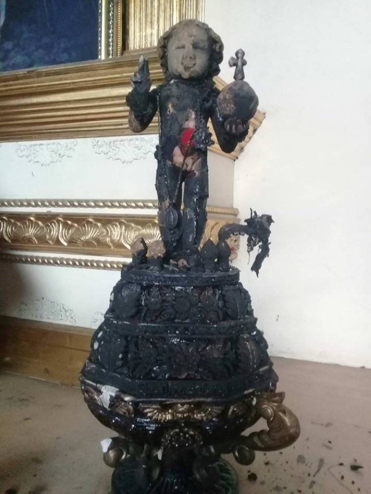 BACOLOD. THE wooden image of Senior Sto. Niño at Santo Niño Parish and Shrine at BBB-Galo Streets in Barangay 20, Bacolod City was burned by an unknown culprit. (SunStar Bacolod)