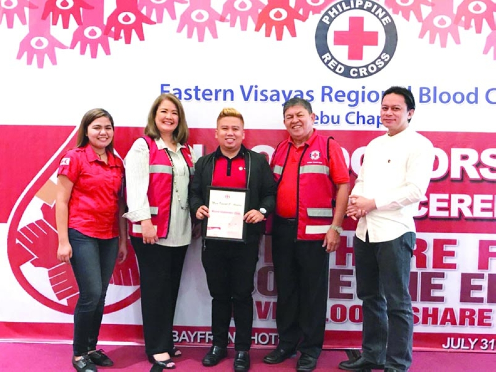GOOD CITIZENSHIP. Philippine Red  Cross and Teleperformance Cebu pose for a group foto during the recognition ceremony. (Contributed photo)