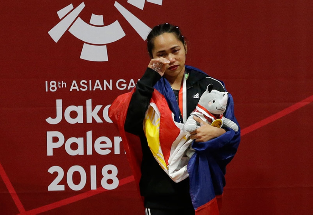 INDONESIA. Hidlyn Diaz celebrates after winning gold at the women's 53 kg weightlifting at the 18th Asian Games in Jakarta, Indonesia, Tuesday, Aug. 21, 2018. (AP)