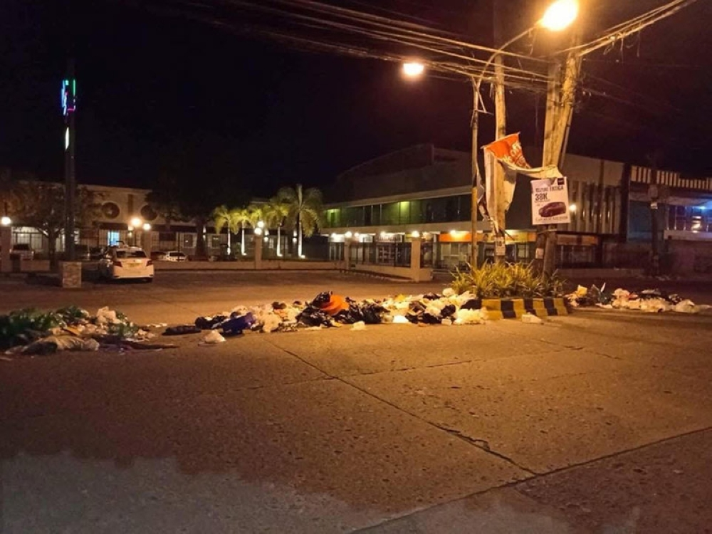 BACOLOD. The garbage that was illegally dumped in the middle of the road at Lopez Jaena Extension on Thurday, August 23. (Cindy Rojas)