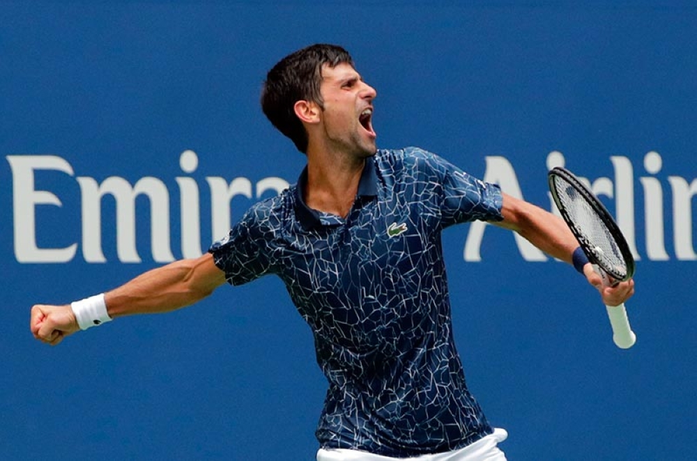 CELEBRATION. Novak Djokovic celebrates after a four-set win against Marton Fucsovics of Hungary  during the first round of the US Open tennis tournament. (AP photo / Frank Franklin II)
