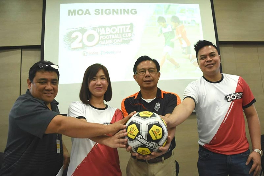 READY TO GO. Organizers of the 20th Aboitiz Cup (from left) Glen Quisido (left) and Cebu Football Association president Ricky Dakay (second from right) with AboitizLand's Farah Mayol (second from left) and Carlo Tenerife (right) during the launching of the 20th edition of the tournament. (SunStar photo / Ruel Rosello)