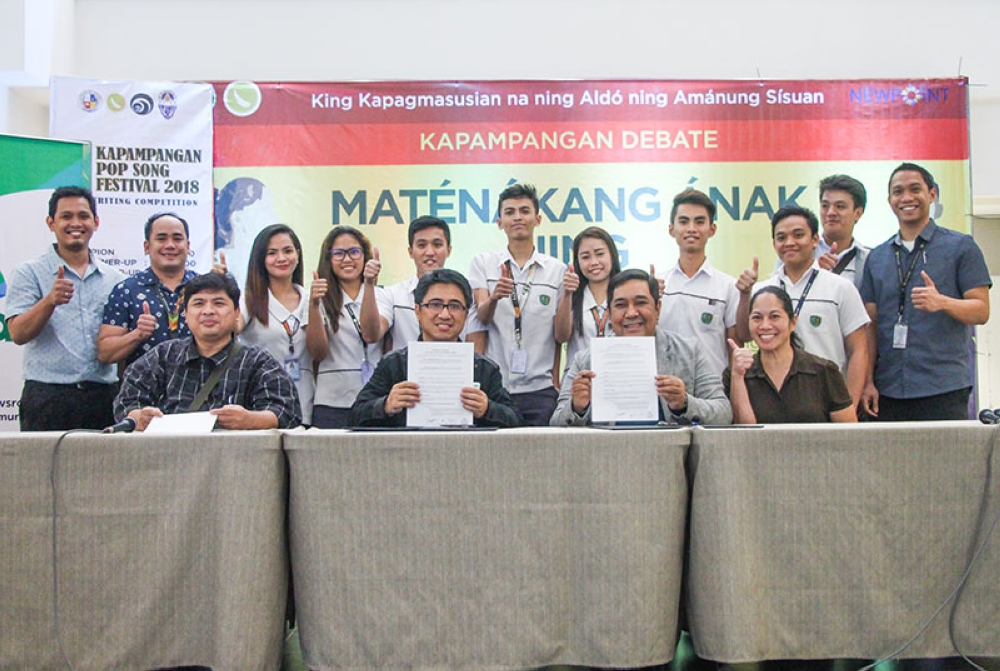PAMPANGA. City College of Angeles president, Dr. Richard Daenos (seated, 2nd, R) and Smart Communications' head for Community Partnerships Darwin Flores (seated 2nd, L), signed the memorandum of understanding on Thursday for the development first-ever Kapampangan Literacy mobile application. Also in the photo are ACTO head for Heritage Conservation Joy Cruz (R) and Kapampangan Language Expert Mike Pangilinan (L). (AC-CIO)