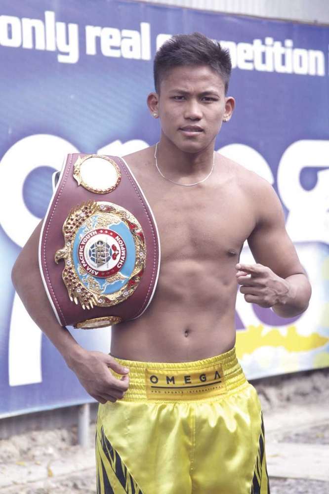 FOR THE COUNTRY. Undefeated world champion Jhack Tepora says Pinoy pro fighters can do well in the Olympics since fights are only three rounds long.  (SunStar File Photo)