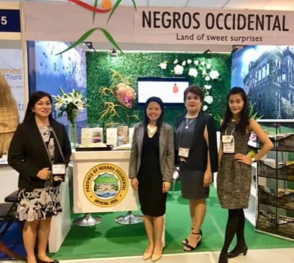 NEGROS Occidental Tourism Division personnel led by Provincial Supervising Tourism Operations Officer Cristine Mansinares (2nd from left) and Senior Tourism Operations Officer Jennylind Cordero (2nd from right) at the province's booth during the 29th Philippine Travel Mart held at SMX Convention Center in Pasay City which ended Sunday. (Contributed Photo)