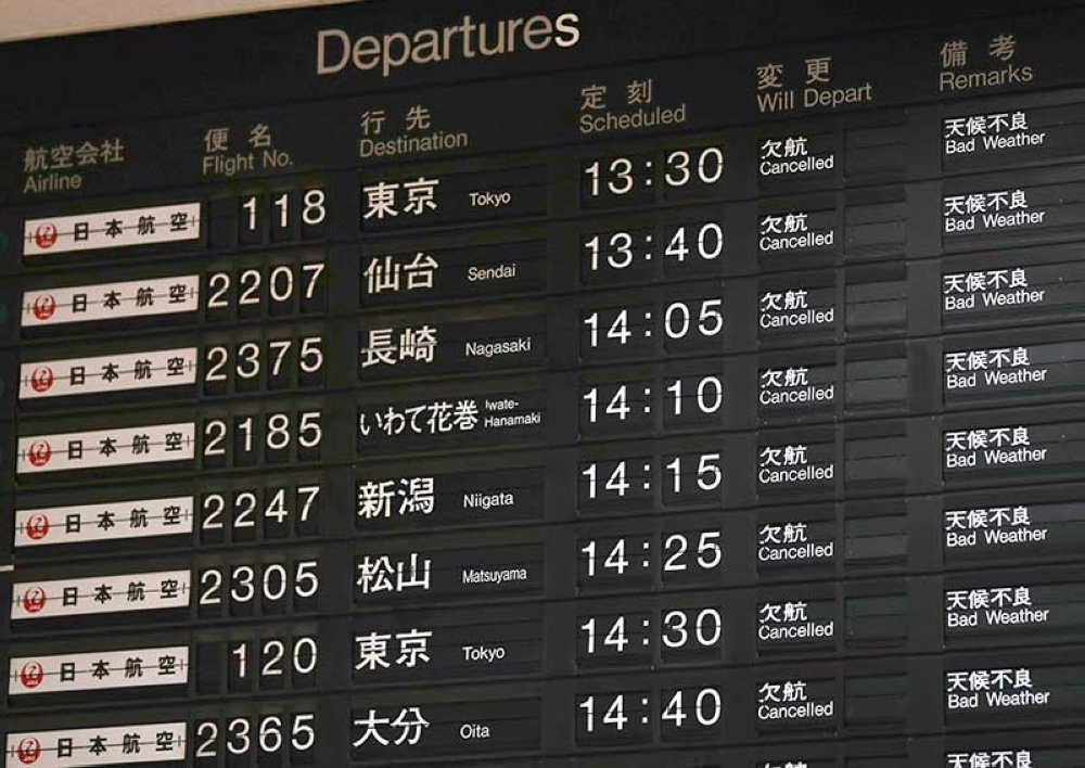 JAPAN. A flight information board shows the cancellation of flights at Osaka airport, western Japan, Tuesday, September 4, 2018. Heavy rain and crashing surf were striking western Japan as powerful Typhoon Jebi neared its Pacific coast Tuesday, disrupting train service and air travel. (AP)