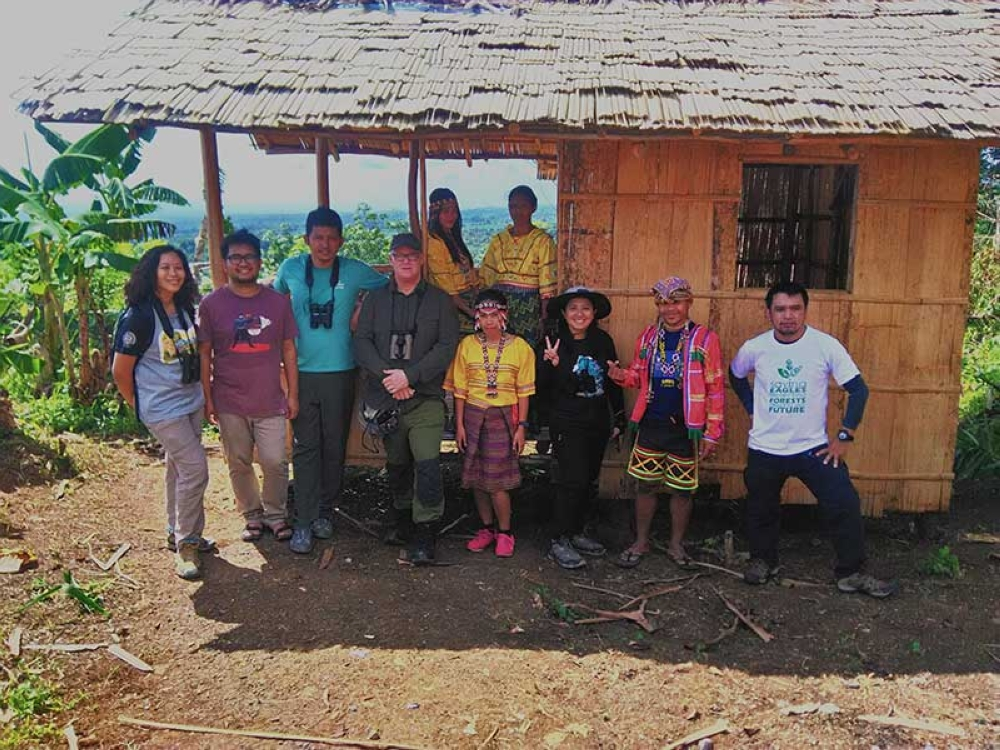DAVAO. Photo op with the Obu Manuvu tour guides with their traditional house behind us. (Contributed Photo)