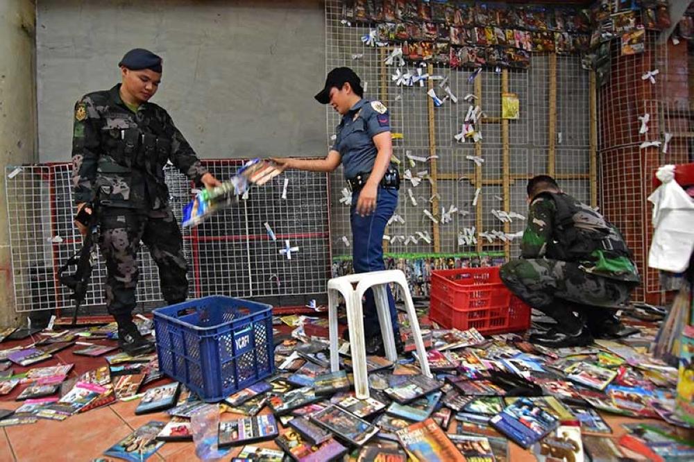 P65-M pirated DVDs seized in raids - SUNSTAR