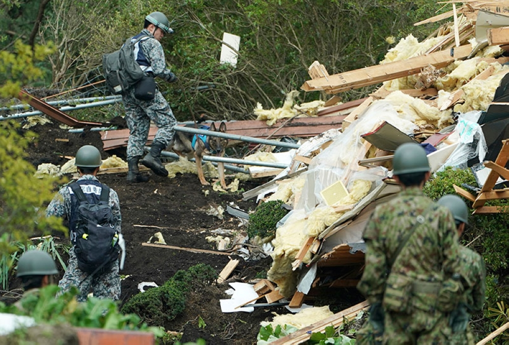 JAPAN. Japan Self-Defense Forces members search missing persons at the site of a landslide triggered by an earthquake in Atsuma town, Hokkaido, northern Japan, Friday, September 7, 2018. A powerful earthquake hit wide areas on Japan's northernmost main island of Hokkaido early Thursday, triggering landslides as well as causing the loss of power. (AP)