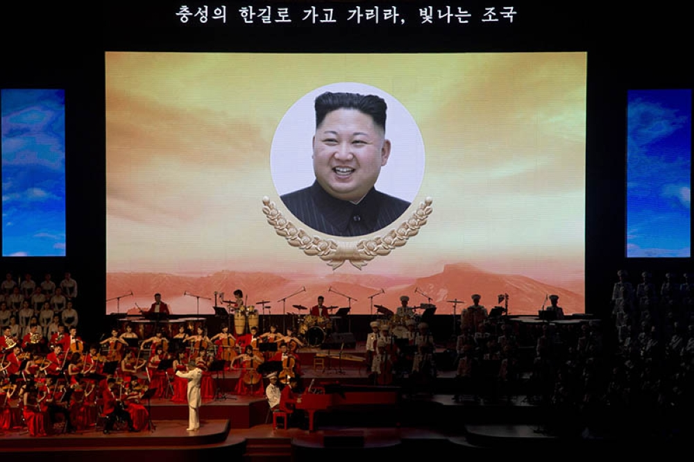 NORTH KOREA. A portrait of North Korean leader Kim Jong Un is displayed on a large screen with the words