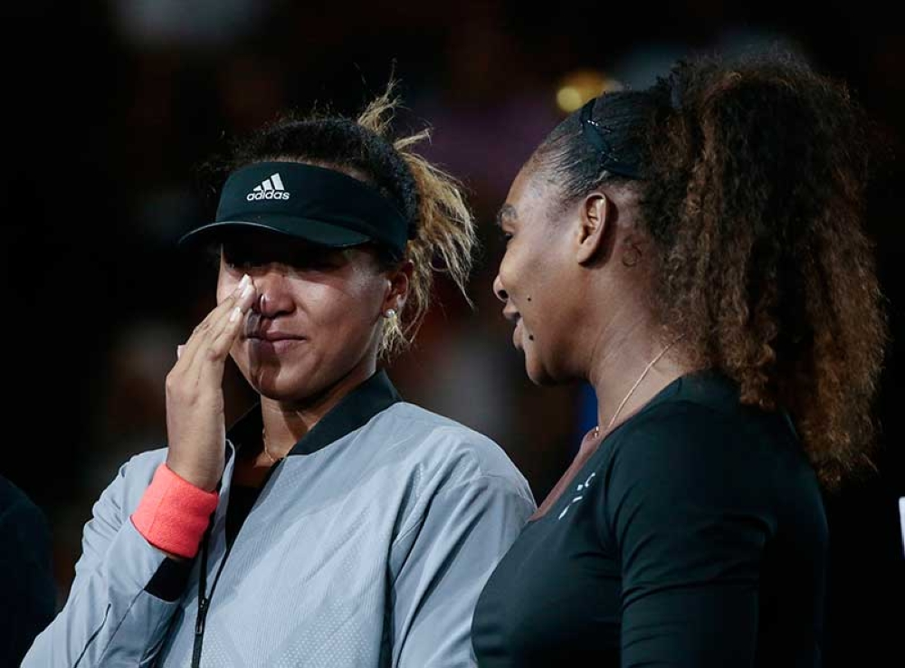 NEW YORK. Naomi Osaka, of Japan, wipes a tear as she talks with Serena Williams after Osaka defeated Williams in the women's final of the U.S. Open tennis tournament, Saturday, Sept. 8, 2018, in New York. (AP Photo)