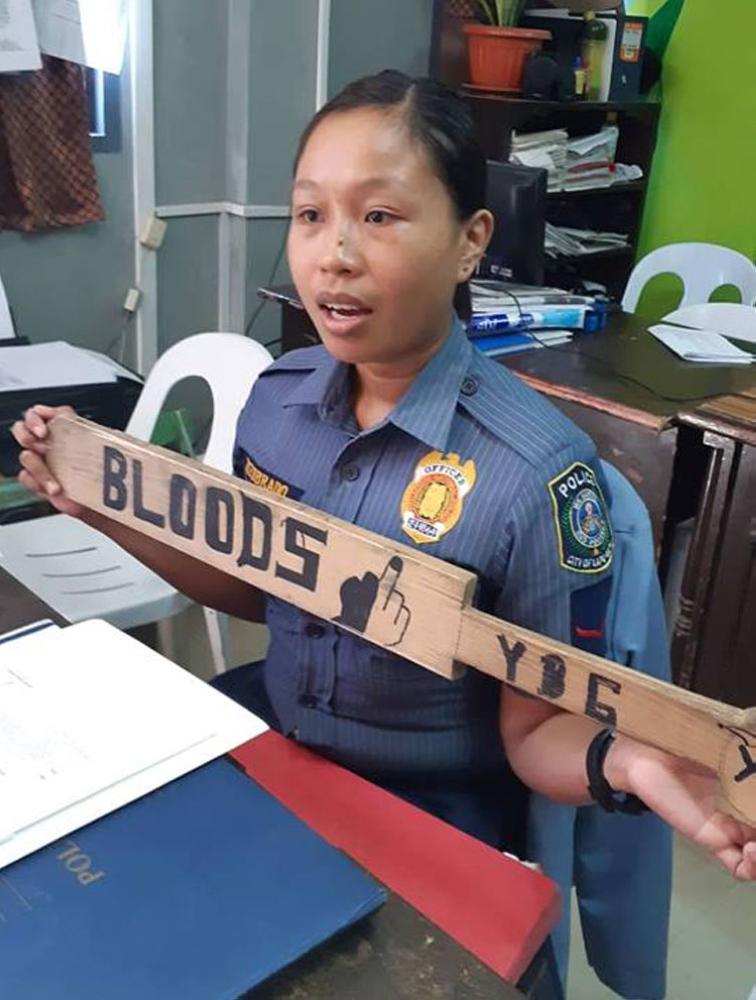 CEBU. P01 Brilyen Zozobrado of Mactan Police Station of Lapu-Lapu City Police Office shows the paddle confiscated during a hazing session last Sunday night.