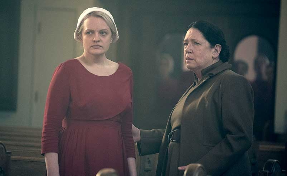 This image released by Hulu shows Elisabeth Moss, left, and Ann Dowd in a scene from