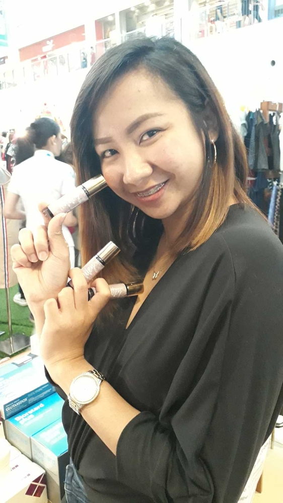 CAGAYAN DE ORO. Nikki Louise Macaspac, together with Hailey Organics' best-selling product: lip tints. (Jo Ann Sablad)