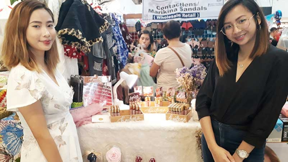 CAGAYAN DE ORO. Macaspac sisters Nikki Louise and Carmina in Hailey Organics' booth during the weekend bazaar in Centrio Ayala Mall last Sunday, September 9. (Jo Ann Sablad)