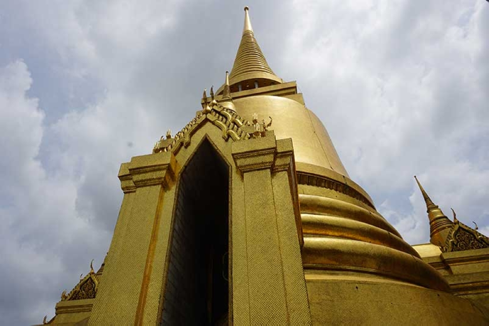 THAILAND. The Phra Siratana Chedi, a structure that looks like a huge, gold bell, contains relics of Lord Buddha. (Kathleen Pastrana)