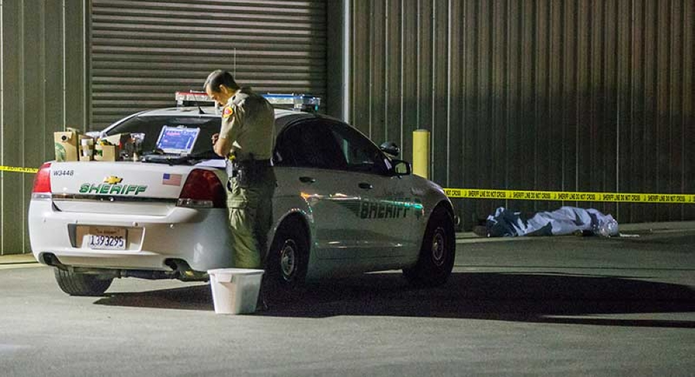 CALIFORNIA. A Kern County sheriff's deputy stands near an area where a shooting victim lies, Wednesday, Sept. 12, 2018, in Bakersfield, Calif. A gunman killed five people, including his wife, before turning the gun on himself, authorities said. (The Bakersfield Californian via AP)