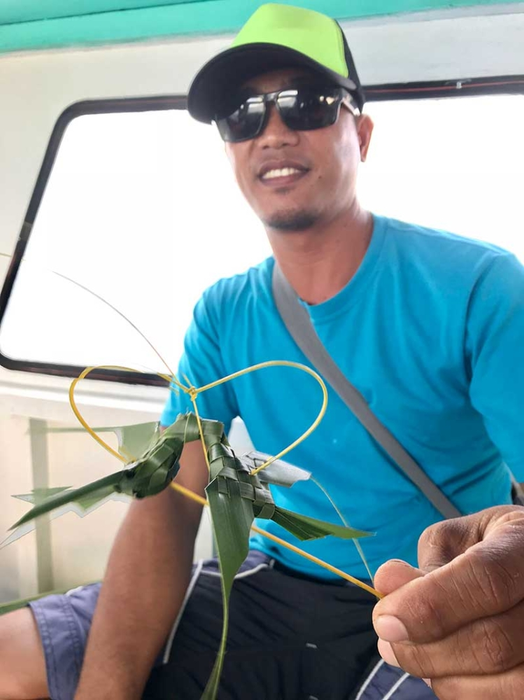 Boat crew Dhan Gogolin shows off a