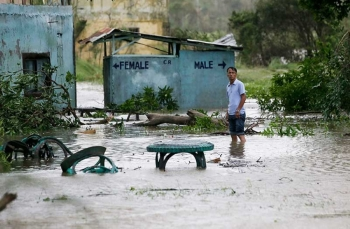 TUGUEGARAO. A resident wades along a flooded area as Typhoon Mangkhut barreled across Tuguegarao city in Cagayan province, northeastern Philippines on Saturday, Sept. 15, 2018. (AP)