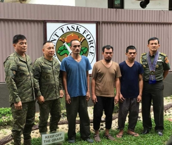 ZAMBOANGA. Joint Task Force Sulu (JTFS) photo handout shows the three Indonesians together with an Indonesian military attaché (right) and Brigadier General Divino Rey Pabayo, JTFS commander (second from left). The Abu Sayyaf freed the three on Saturday, September 15. (Bong Garcia)