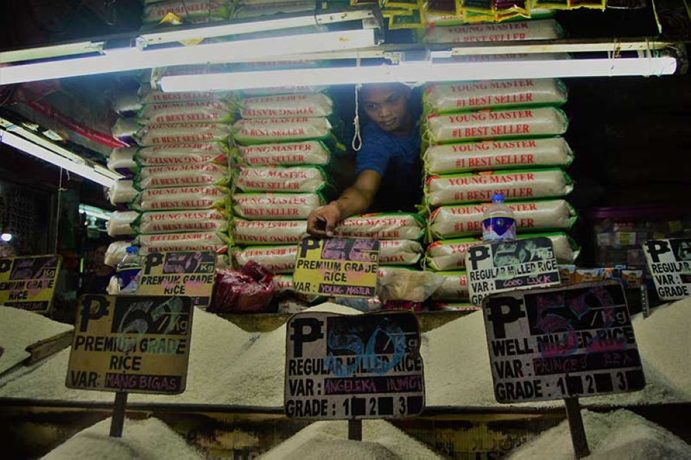 CAGAYAN DE ORO. A storekeeper tends to the rice on display at the Cogon public market as prices of this staple has soared, while the release of thousands of bags of imported rice was delayed by the Bureau of Customs in Northern Mindanao due to the volume of goods that came in recently. (Jigger J. Jerusalem)