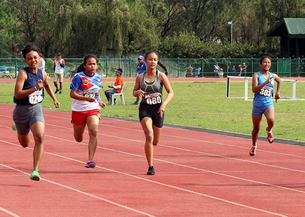 BAGUIO. Girls compete in the 100 meter dash of hoping to bring home the gold for their respective local government units in the ongoing Batang Pinoy National Championships at the Baguio Athletic Bowl. (Photo by Jean Nicole Cortes)