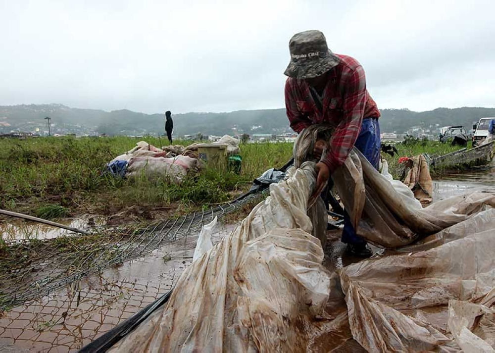 BENGUET. A farmer salvage scattered plastic cover after his crops were damaged by Typhoon Ompong. La Trinidad's strawberry farm was flooded during the onslaught of the typhoon which left nearly 60 dead. (Photo by Jean Nicole Cortes)