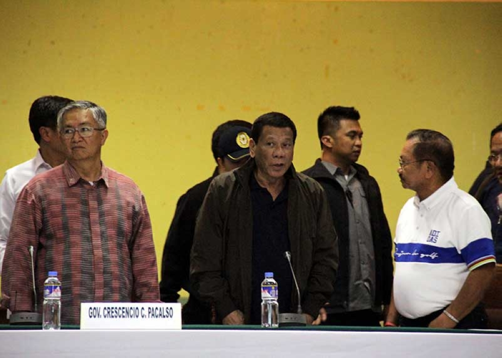 BAGUIO. President Rodrigo Duterte oversees the situation briefing to assess the damages and casualties of Typhoon Ompong in the Cordillera Administrative Region at the Benguet Provincial Capitol in La Trinidad on September 17. On the same day, the President provided assistance to the families of the victims affected by the typhoon. (Photo by Lauren Alimondo)