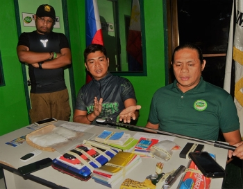 ILIGAN. Philippine Drug Enforcement Agency (PDEA) officials present to the media the suspected shabu and other items confiscated from four suspects arrested during a raid early Wednesday morning,  in Iligan City. Second from left is Juvenal Azurin, PDEA regional director for the Autonomous Region in Muslim Mindanao, and Benjamin Recites, PDEA-10 Investigation Agent. (Jigger J. Jerusalem)