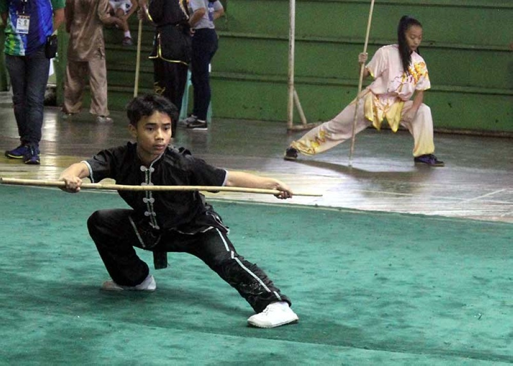 BAGUIO. Baguio City's Ranyag Anthony Quitasol performs his routine during the wushu taulo competition of the Batang Pinoy national championships at the PFVR gym. (Photo by Roderick Osis)