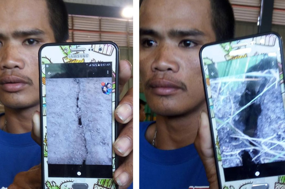 CEBU. John Rey Lapitan, a resident of Sitio Tagaytay in Barangay Tina-an, shows photos of the cracks they found near their home that grew within the span of three weeks before the landslide last Thursday. (Justin K. Vestil)