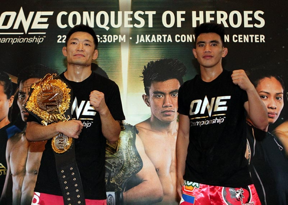 "INDONESIA. Team Lakay's Joshua Pacio takes on ONE Championship strawweight champion champion Yoshitaka Naito in the main event of ""Conquest of Heroes"" set tonight (September 22) at the Jakarta Convention Center in Jakarta, Indonesia. (ONE Championship photo)"