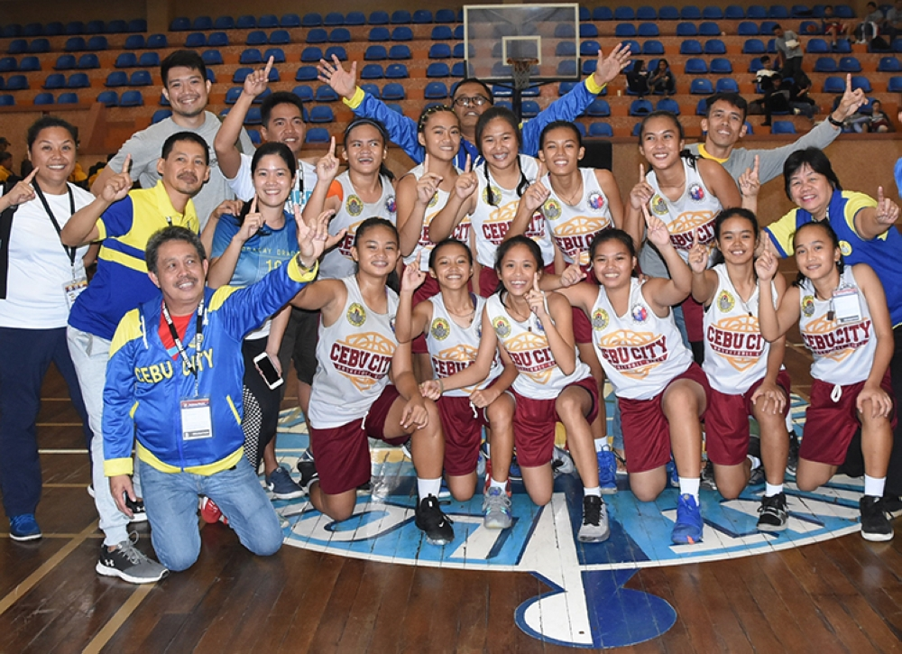 Champion. Members of the Cebu City girls' basketball team are all smiles after winning the gold medal in the Batang Pinoy national meet. (SunStar Foto/Ruel Rosello)