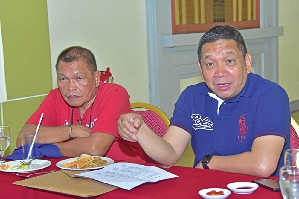 ALL SET. Samahang Basketbol ng Pilipinas (SBP) executive program officer Ronel Leuterio, right, says the SBP 3x3 Under 16 Regional Finals will get underway today during a press conference held at The Royal Mandaya Hoteli on Friday, September 21. Also in photo is tournament manager Billy Cruzada. (Macky Lim)