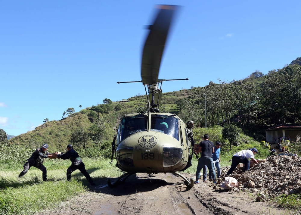 BAGUIO. The Philippine Air Force through its Tactical Operations Group 1 under Lt. Col. Ronnie Cabingas conducts aerial relief operations at isolated areas in Benguet while assisting members of the inter-agency Rapid Damage Assessment and Needs Analysis in a survey of landslide-hit areas by Typhoon Ompong in the Cordillera. (Contributed photo)
