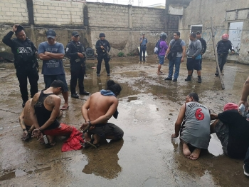 Busted. Twelve suspects were arrested in a drug den in Sitio Mananga, Barangay Tabunok, Talisay City yesterday afternoon. The police say they are  bigtime players and may have links to the Parojinog ring in Ozamis City. (Contributed Foto /Talisay City Police Office)