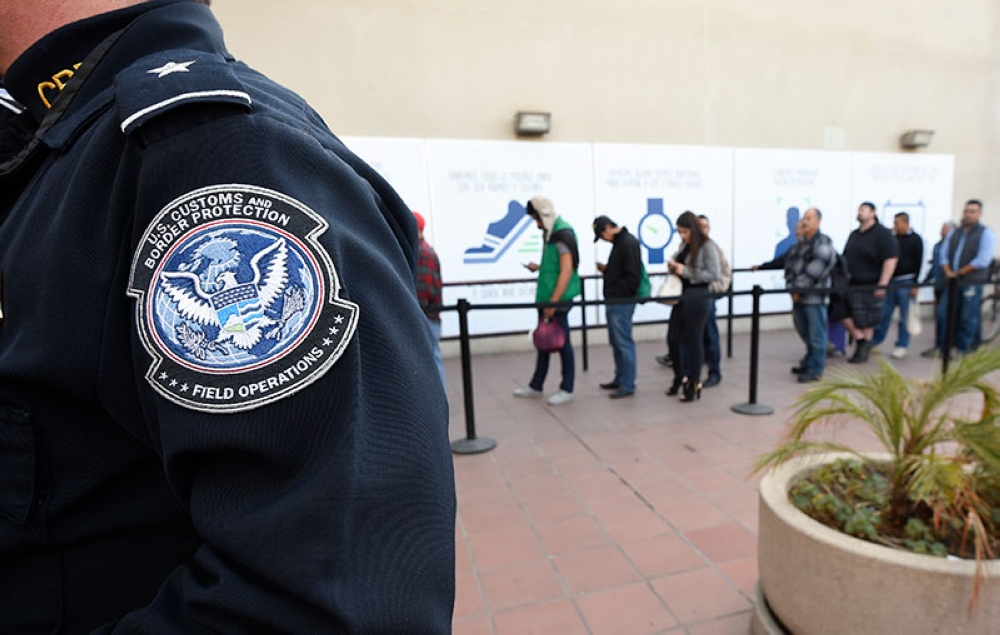 SAN DIEGO. In this Dec. 10, 2015, file photo, pedestrians crossing from Mexico into the United States at the Otay Mesa Port of Entry wait in line in San Diego. The Trump administration is proposing rules that could deny green cards to immigrants if they use Medicaid, food stamps, housing vouchers and other forms of public assistance. (AP Photo)