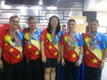 From left, Manny Nierra, Absalon Serrano Jr., Crytsal Christine Chavez, James Young and Tans Bernas wear their medal during the simple recognition rites held at the SM Lanang Premier Bowling Center Saturday evening. Not in photo is Mayor Al Langkuno. (Adam Morrell)