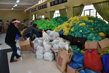 The Itogon Training Center temporarily houses relief goods and other supplies needed by more than 400 families living in evacuation centers, affected by typhoon Ompong last week. (Photo by Redjie Melvic Cawis)